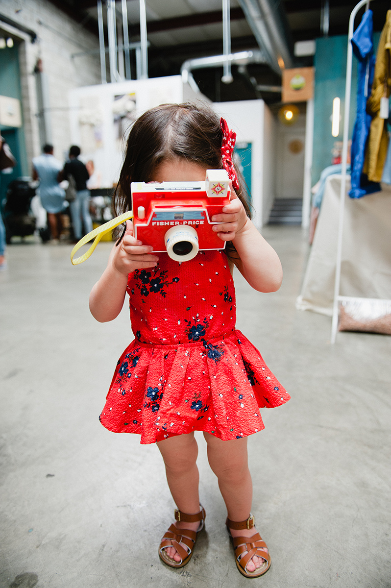 Little girl with camera at the ShopUp