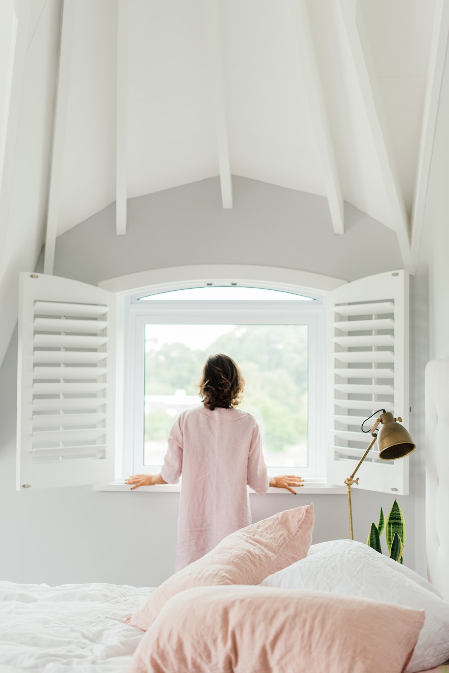 woman window restful natural